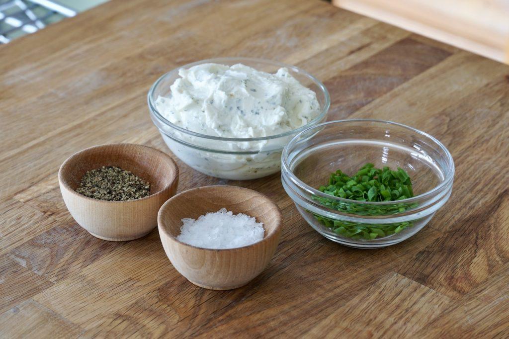Herbed cream cheese, freshly chopped chives plus kosher salt and black pepper