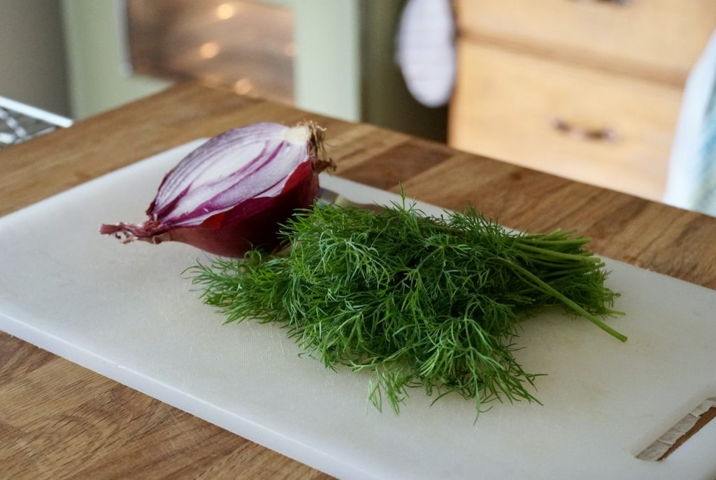 Fresh dill and half of a red onion