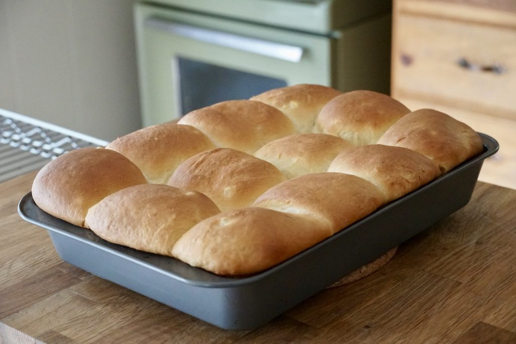 Freshly baked dinner rolls out of the oven