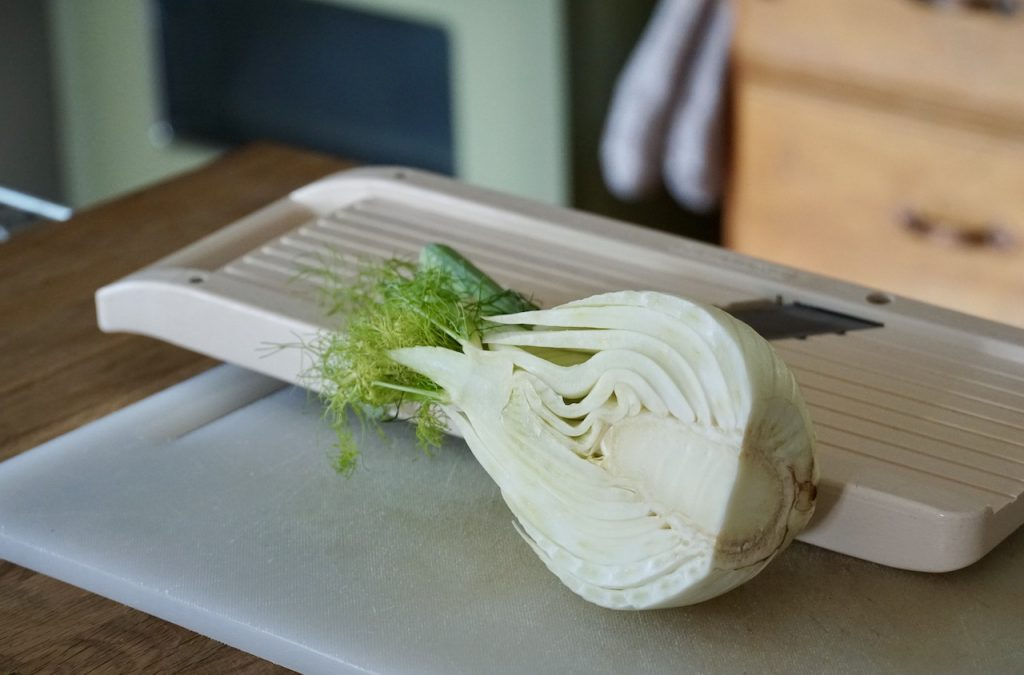 Hald a bulb of fennel ready to be shaved thinly
