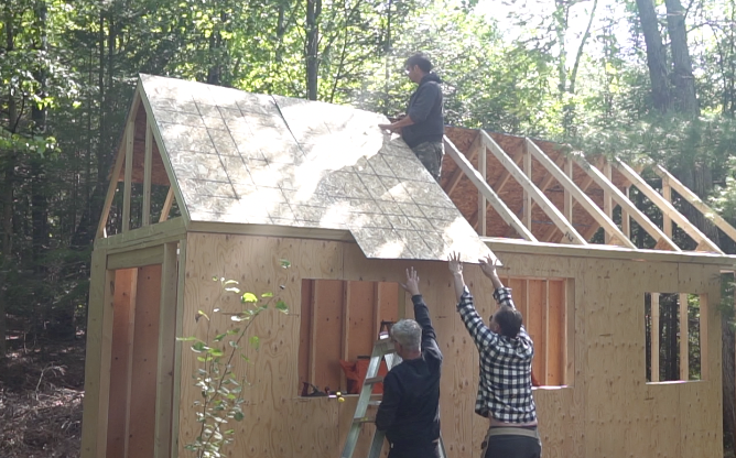 Lifting the roof sheathing in place